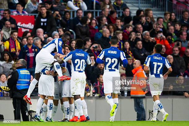 Players of RCD Espanyol celebrate after Sergio Garcia scored the opening goal during the La Liga match between FC Barcelona and RCD Espanyol at Camp...