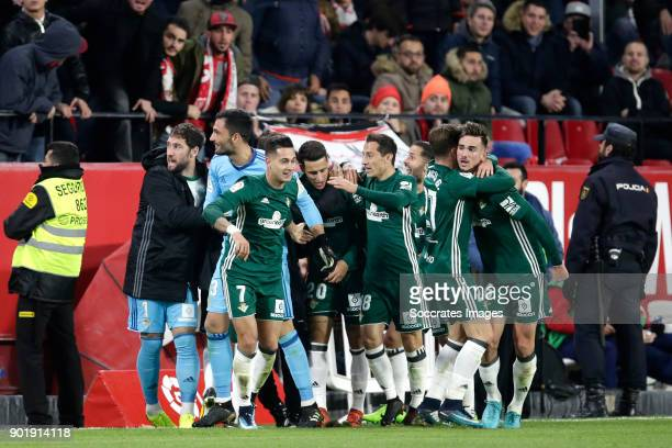 players of Real Betis celebrates 24 during the La Liga Santander match between Sevilla v Real Betis Sevilla at the Estadio Ramon Sanchez Pizjuan on...