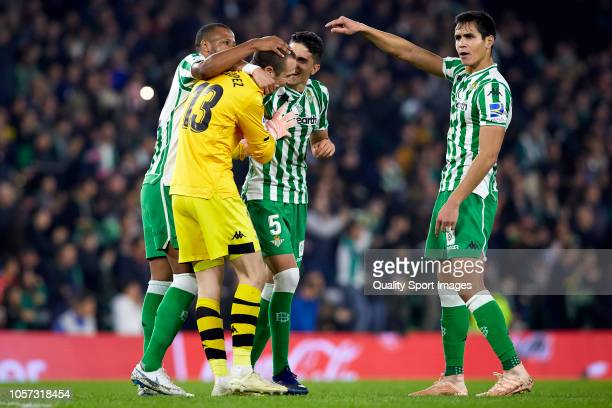 Players of Real Betis celebrates with his teammate Pau Lopez after the first goal of his team during the La Liga match between Real Betis Balompie...