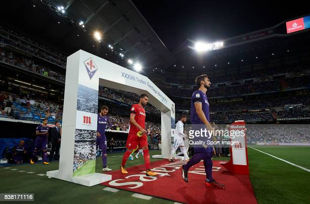 Players of Real Madrid and Fiorentina makes their way out on to the pitch prior to kickoff at the Trofeo Santiago Bernabeu match between Real Madrid...