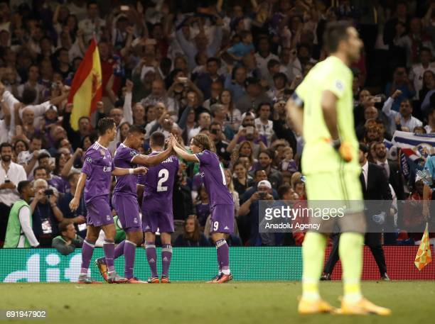 Players of Real Madrid celebrate after scoring a goal during UEFA Champions League Final soccer match between Juventus and Real Madrid at Millennium...