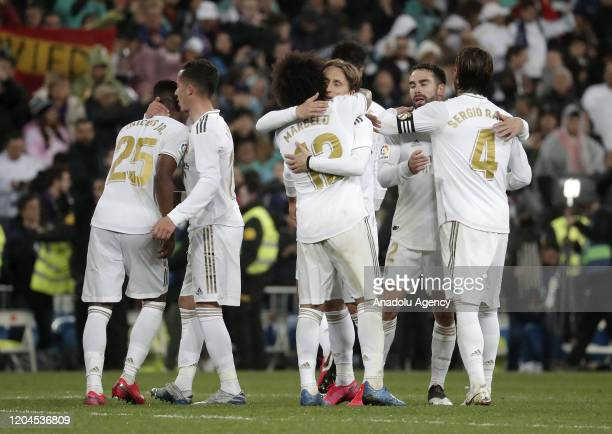 Players of Real Madrid celebrate after the Spanish League football match between Real Madrid and Barcelona at the Santiago Bernabeu stadium in Madrid...