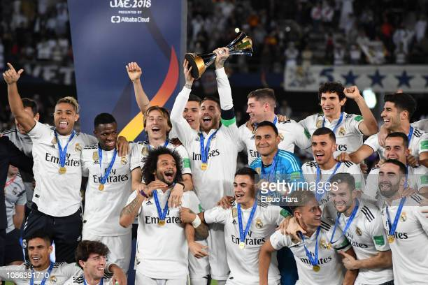 Players of Real Madrid celebrate the victory as captain Sergio Ramos lifts the trophy after the FIFA Club World Cup UAE 2018 Final between Real...