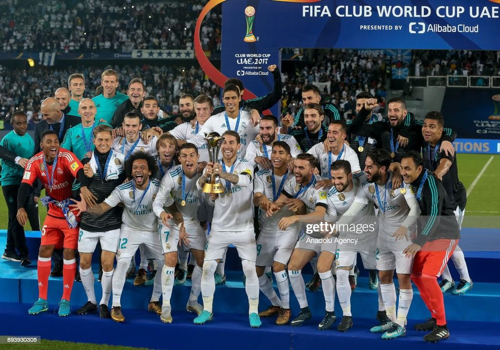 Players of Real Madrid celebrate with the trophy after the 2017 FIFA Club World Cup final match between Real Madrid and Gremio at the Zayed Sports City Stadium in Abu Dhabi, United Arab Emirates on December 16, 2017.