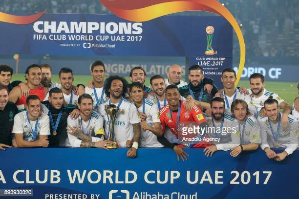 Players of Real Madrid celebrate with the trophy after the 2017 FIFA Club World Cup final match between Real Madrid and Gremio at the Zayed Sports...
