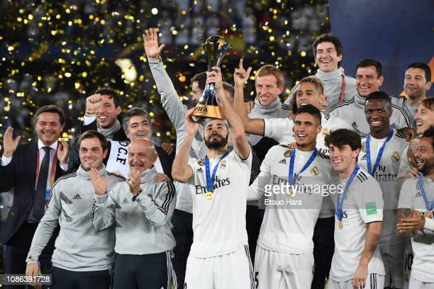 Players of Real Madrid celebrate with the trophy after the FIFA Club World Cup UAE 2018 Final between Real Madrid and Al Ain at the Zayed Sports City...