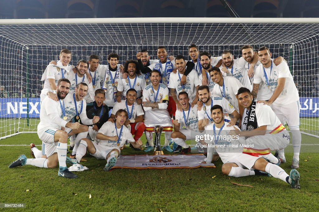 Players of Real Madrid celebrate with the trophy after the FIFA Club World Cup UAE 2017 Final match between Real Madrid CF and Gremio FBPA at Zayed Sports City Stadium on December 16, 2017 in Abu Dhabi, United Arab Emirates.