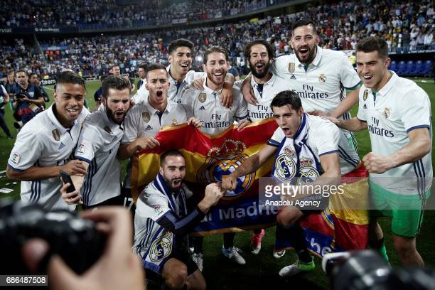 Players of Real Madrid celebrates their championship after the La Liga final match between Malaga and Real Madrid at La Rosaleda Stadium on May 21...