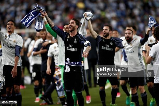 Players of Real Madrid celebrates their championship after the La Liga final match between Malaga and Real Madrid at La Rosaleda Stadium on May 21...