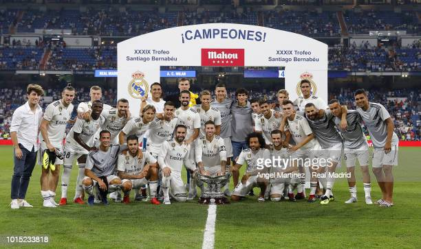 Players of Real Madrid celebrates with the trophy after the Trofeo Santiago Bernabeu match between Real Madrid and AC Milan at Estadio Santiago...