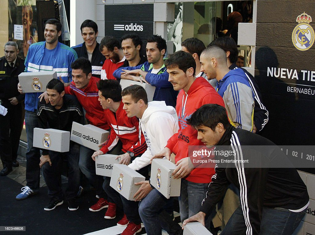 Players of Real Madrid CF and Real Madrid Basketball (L-R) Felipe Reyes, Angel Di Maria, Carlos Suarez, Antonio Adan, Sergio Rodriguez, Ricardo Carvalho, Jose Callejon, Alvaro Arbeloa, Nacho Fernandez, Xabi Alonso, Ricardo Kaka, Iker Casillas and Alvaro Morata attend the opening of the new 'Adidas' store at the Santiago Bernabeu stadium on February 21, 2013 in Madrid, Spain.