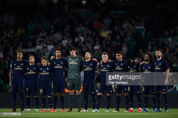 Players of Real Madrid during a silence minute prior to the Liga match between Real Betis Balompie and Real Madrid CF at Estadio Benito Villamarin on...