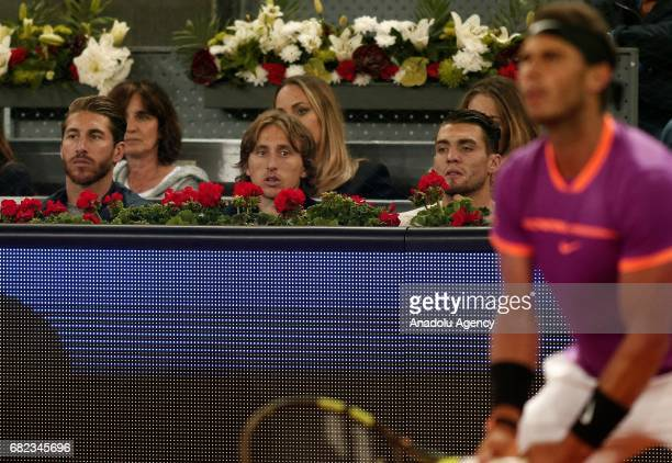 Players of Real Madrid football team Sergio Ramos Luka Modrid and Mateo Kovacevic watch the ATP Masters 1000 Open men's quarter final tennis match...
