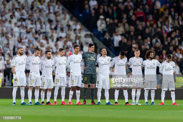 Players of Real Madrid hold a minute of silence prior to the Liga match between Real Madrid CF and RC Celta de Vigo at Estadio Santiago Bernabeu on...