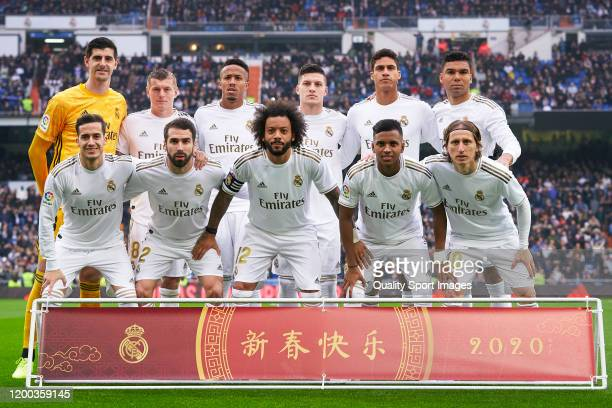 Players of Real Madrid line up for a team photo prior to the Liga match between Real Madrid CF and Sevilla FC at Estadio Santiago Bernabeu on January...