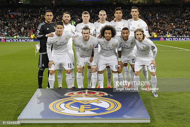 Players of Real Madrid pose before the UEFA Champions League Round of 16 Second Leg match between Real Madrid CF and AS Roma at Estadio Santiago...