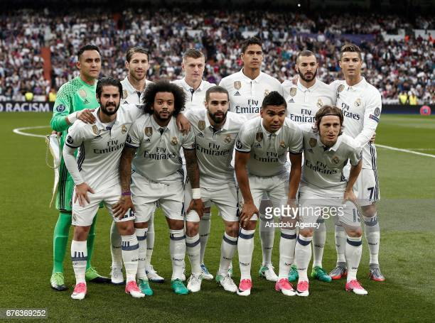 Players of Real Madrid pose for a photo ahead of UEFA Champions League semi final match between Real Madrid and Atletico Madrid at Santiago Bernabeu...