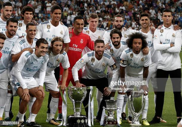 Players of Real Madrid pose for a photo with their 2016/2017 Champions League La Liga and Bernabeu trophies ahead of La Liga soccer match between...