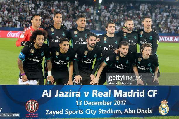 Players of Real Madrid pose for a team photo ahead of the 2017 FIFA Club World Cup semi final match between Al Jazira and Real Madrid at Zayed Sports...