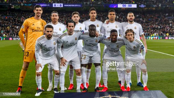 Players of Real Madrid pose for a team photo during the UEFA Champions League round of 16 first leg match between Real Madrid and Manchester City at...