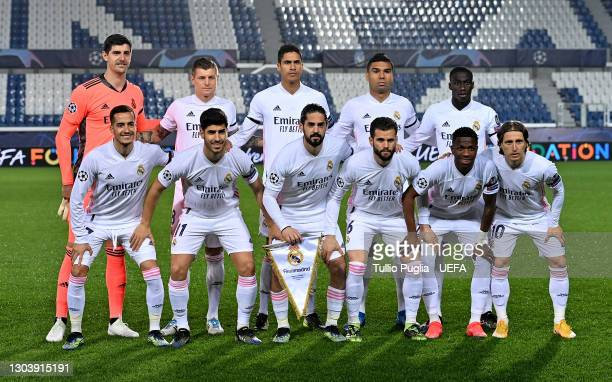 Players of Real Madrid pose for a team photograph prior to the UEFA Champions League Round of 16 match between Atalanta and Real Madrid at Gewiss...