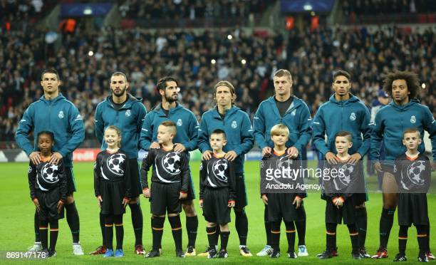 Players of Real Madrid stand in silence ahead of the UEFA Champions League Group H soccer match between Tottenham Hotspur FC and Real Madrid at...