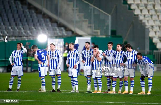 Players of Real Sociedad look on during a penalty shoot out during the Supercopa de Espana Semi Final match between Real Sociedad and FC Barcelona at...