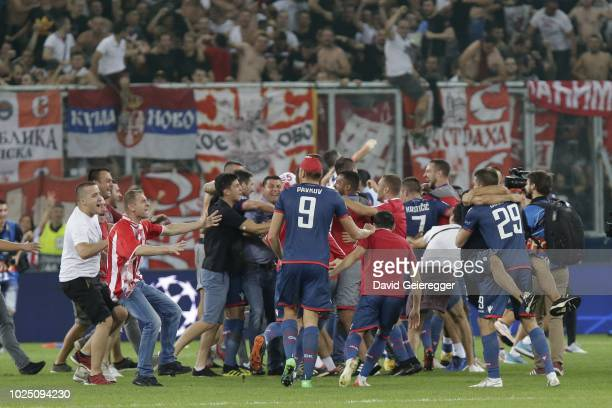 Players of Red Star Belgrade celebrate with their fans after the UEFA Champions League match between FC Salzburg and Red Star Belgrade at Red Bull...