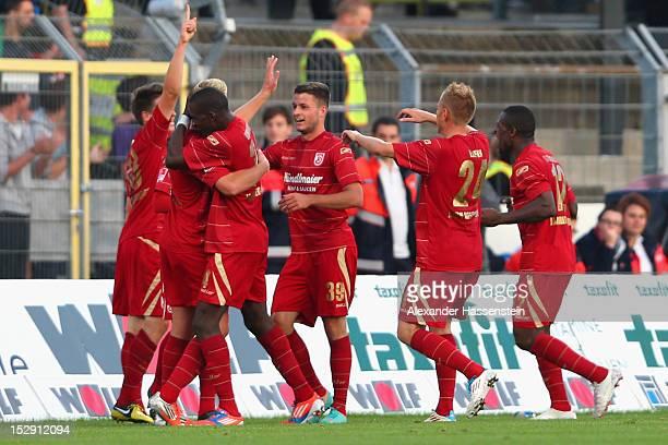 Players of Regensburg celebrate the 2nd team goal the Second Bundesliga match between Jahn Regensburg and FC St. Pauli at Jahnstadion on September...