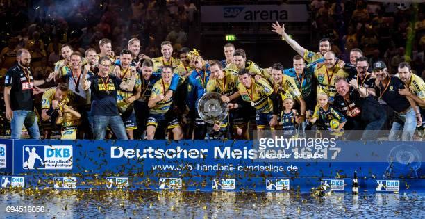 Players of Rhein Neckar Loewen celebrate the championship during the DKB HBL match between Rhein Neckar Loewen and MT Melsungen at SAP Arena on June...
