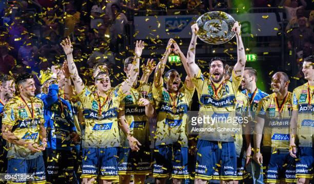 Players of Rhein Neckar Loewen celebrate the championship with the trophy during the DKB HBL match between Rhein Neckar Loewen and MT Melsungen at...