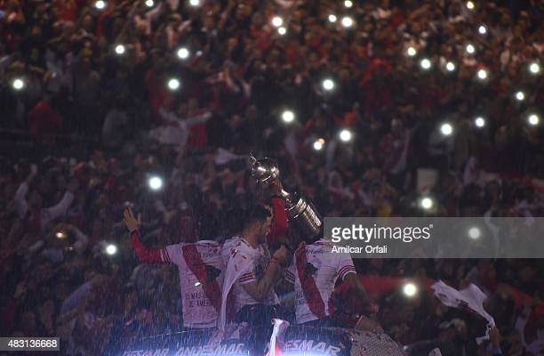 Players of River celebrate with the Copa Libertadores trophy after a second leg final match between River Plate and Tigres UANL as part of Copa...