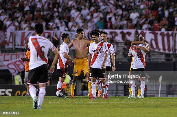 Players of River Plate and Tigres exchange jerseys after the match as part of second round of Group 6 of Copa Bridgestone Libertadores 2015 at...