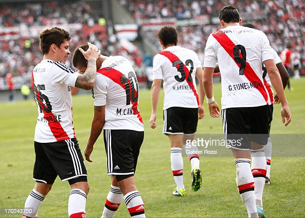 Players of River Plate celebrate a goal during a match between River Plate and Independiente as part of the Torneo Final 2013 at the Monumental...