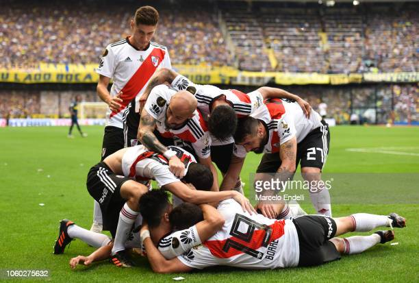 Players of River Plate celebrate after Carlos Izquierdoz of Boca Juniors scored an own goal during the first leg match between Boca Juniors and River...