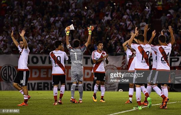 Players of River Plate celebrate after winning a match during a match between River Plate and Independiente as part of fifth round of Torneo...