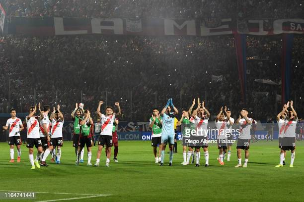 Players of River Plate celebrate classifying to the semifinals after a match between Cerro Porteño and River Plate as part of Quarter Finals of Copa...