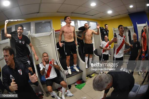 Players of River Plate celebrate in the dressing room after a match between Boca Juniors and River Plate as part of Superliga 2018/19 at Estadio...