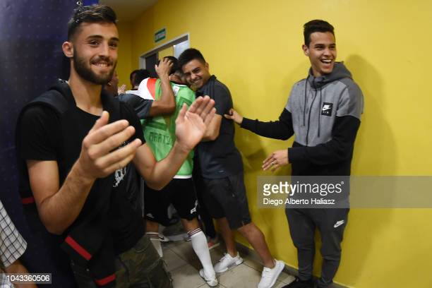Players of River Plate celebrate in the visitor's dressing room after a match between Boca Juniors and River Plate as part of Superliga 2018/19 at...