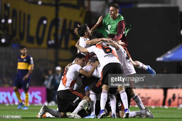 Players of River Plate celebrate qualifying to the final after the Semifinal second leg match between Boca Juniors and River Plate as part of Copa...