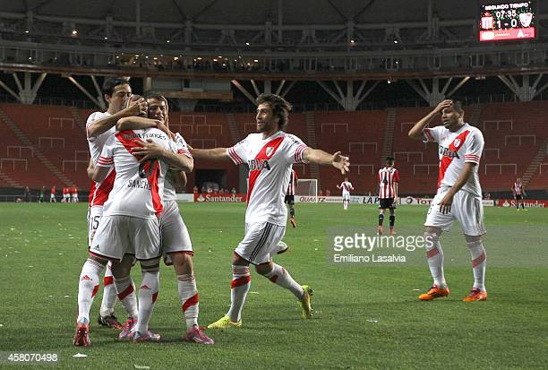 Players of River Plate celebrate the firs goal of their team scored by Rodrigo Mora during a first leg match between Estudiantes and River Plate as...