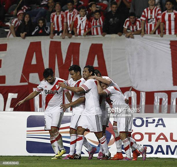 Players of River Plate celebrate the second goal of their team scored by Jonathan Schunke during a first leg match between Estudiantes and River...
