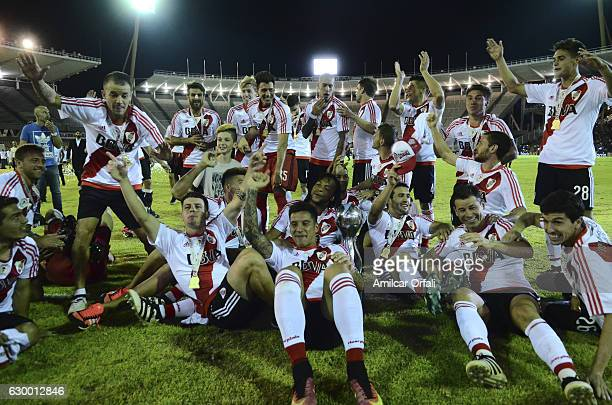 Players of River Plate celebrate with the trophy after a final match between River Plate and Rosario Central as part of Copa Argentina 2016 at Mario...