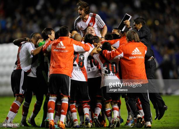 Players of River Plate celebrates after win a match between Boca Juniors and River Plate as part of 10th round of Torneo Final 2014 at Alberto J...