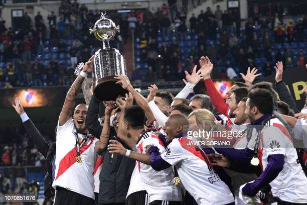 TOPSHOT Players of River Plate hold the trophy as they celebrate after winning the second leg match of the allArgentine Copa Libertadores final...