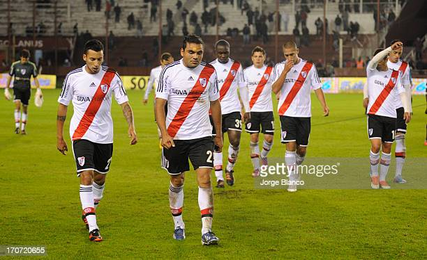 Players of River Plate leave the field after loose a match as part of the 18th round of the Torneo Final 2013 at Ciudad de Lanus stadium on June 16...