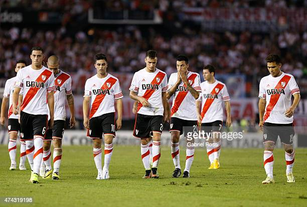 Players of River Plate leave the field after losing a first leg match between River Plate and Cruzeiro as part of quarterfinals of Copa Bridgestone...