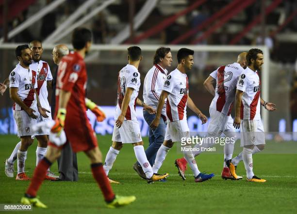 Players of River Plate leave the field at the end of the first half during a second leg match between Lanus and River Plate as part of the semifinals...