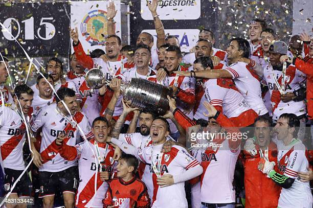 Players of River Plate lift the Copa Libertadores trophy after the final match between River Plate and Tigres UANL as part of Copa Bridgestone...