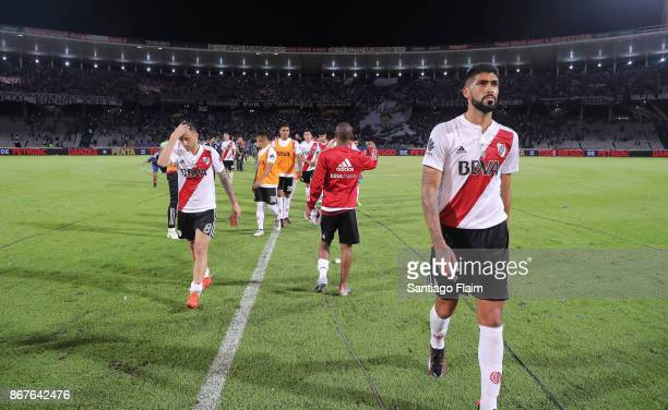 Players of River Plate look dejected after a match between Talleres and River Plate as part of Superliga 2017/18 at Mario Alberto Kempes Stadium on...